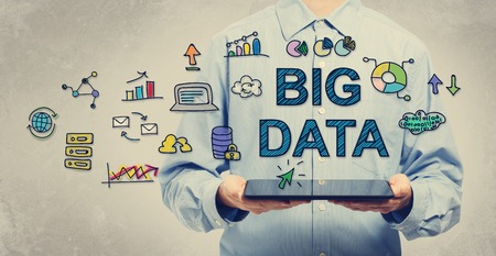 big body: Big Data concept with young man holding a tablet computer Stock Photo