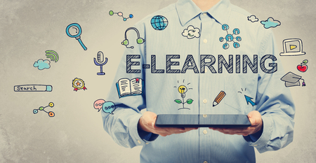E-learning concept with young man holding a tablet computer Stock Photo