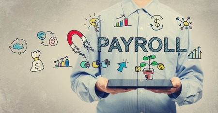 hand job: Payroll concept with young man holding a tablet computer Stock Photo