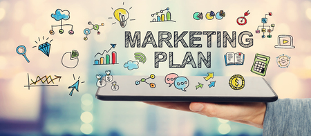 Marketing Plan concept with man holding a tablet computer