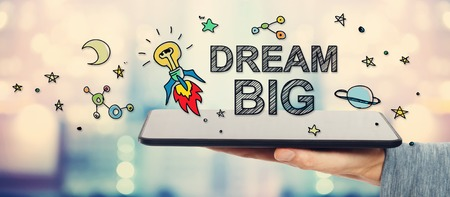 Dream Big concept with man holding a tablet computer Stock Photo