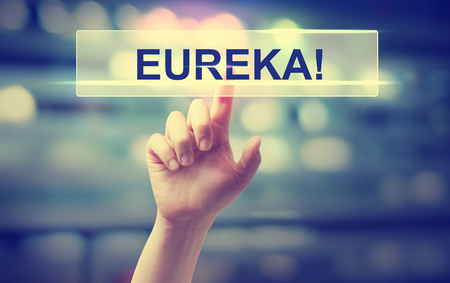 eureka: Eureka concept with hand pressing a button on blurred abstract background