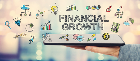 financial growth: Financial Growth concept with man holding a tablet computer Stock Photo