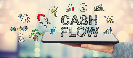wide: Cash Flow concept with man holding a tablet computer Stock Photo