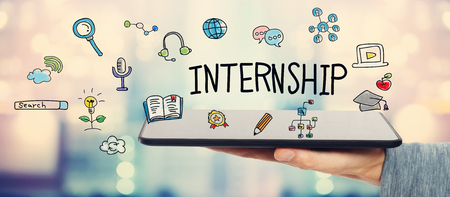 internship: Internship concept with man holding a tablet computer Stock Photo