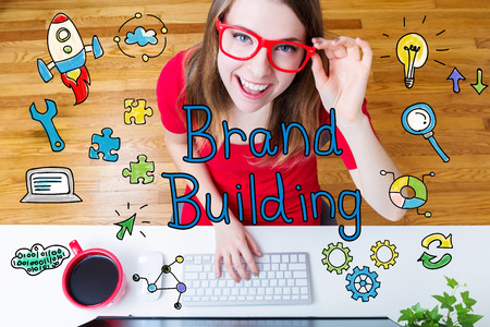 small business woman: Brand Building concept with young woman wearing red glasses in her home office Stock Photo