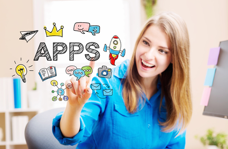 web development: APPS concept with young woman in her home office Stock Photo