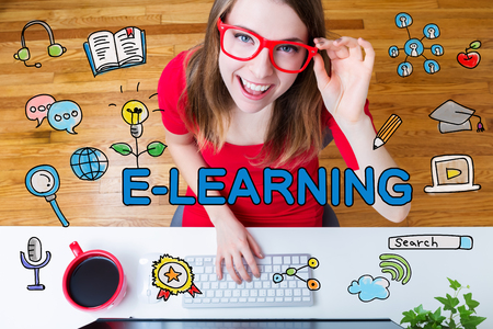 elearning: E-Learning concept with young woman with red glasses in her home office