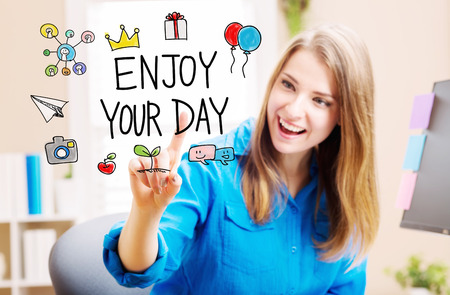 your point: Enjoy Your Day concept with young woman in her home office
