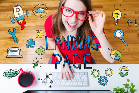 landing: Landing Page concept with young woman wearing red glasses in her home office Stock Photo