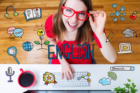 English concept with young woman wearing red glasses in her home office