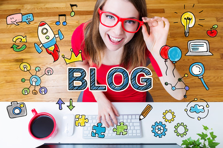Blog concept with young woman wearing red glasses in her home office