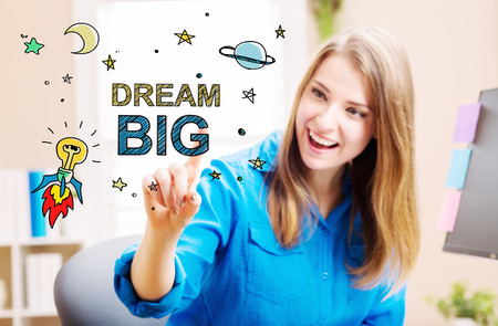 future business: Dream Big concept with young woman in her home office