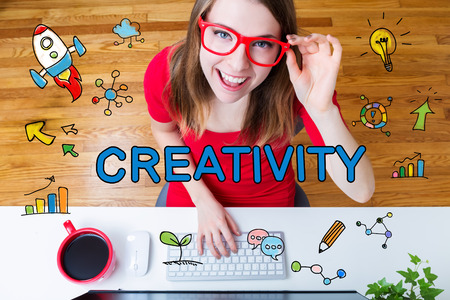 small business computer: Creativity concept with young woman with red glasses in her home office