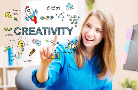 Creativity concept with young woman in her home office