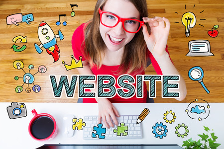 office computer: Website concept with young woman wearing red glasses in her home office