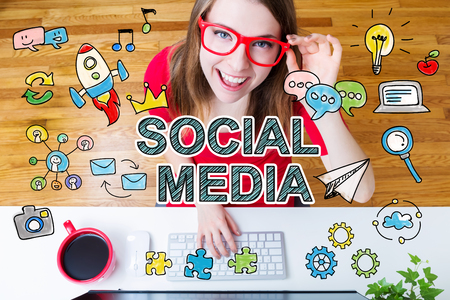 Social Media concept with young woman wearing red glasses in her home office