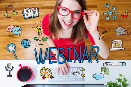 women: Webinar concept with young woman with red glasses in her home office