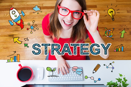 Strategy concept with young woman with red glasses in her home office