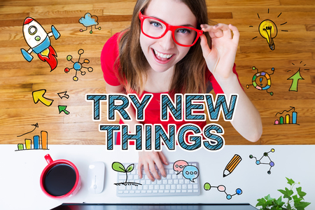 try: Try New Things concept with young woman with red glasses in her home office