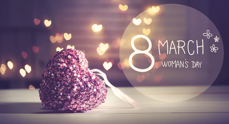 8 march: Womans Day message with pink heart with heart shaped lights
