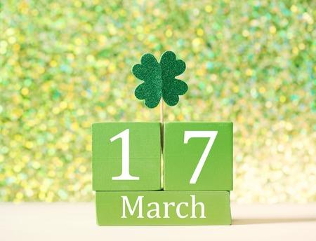 Saint Patricks Day green clover ornament with wooden block calendar