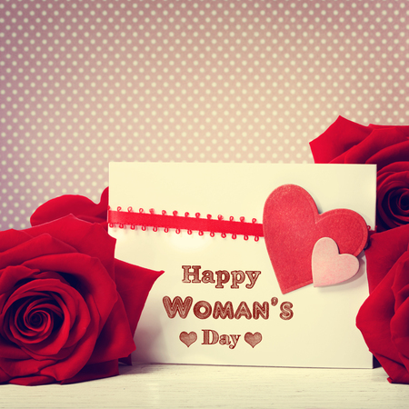 womans: Womans day message card with red roses Stock Photo