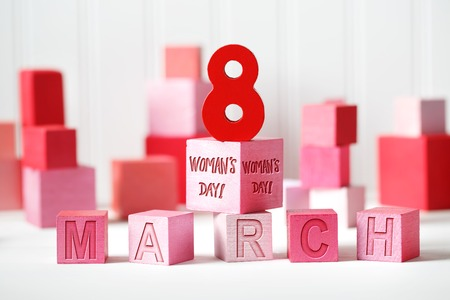 Womans Day - March 8 message with red and pink wooden blocks Stock Photo