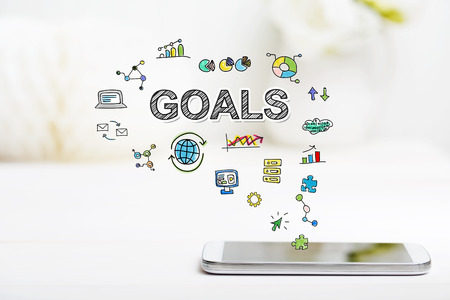 multiple targets: Goals concept with smartphone on white table Stock Photo