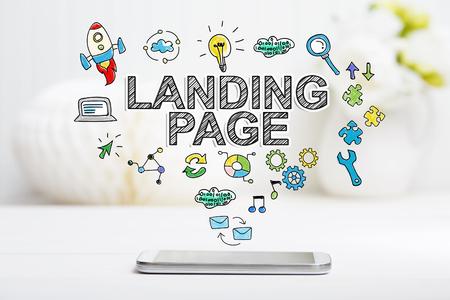 Landing Page-Konzept mit Smartphone auf weißem Tisch Standard-Bild - 53023294