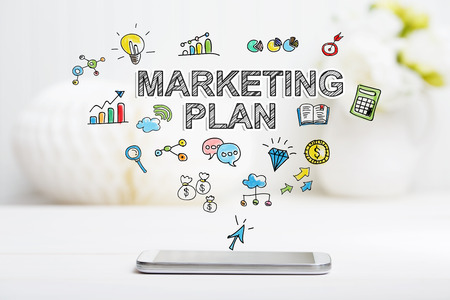 Marketing Plan concept with smartphone on white table