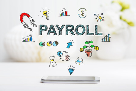 payroll: Payroll concept with smartphone on white table Stock Photo