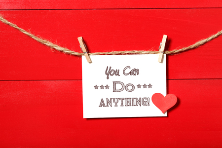 clothespins: You can do anything message card hanging with clothespins Stock Photo