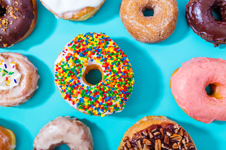 assorted: Assorted donuts on a pastel blue background