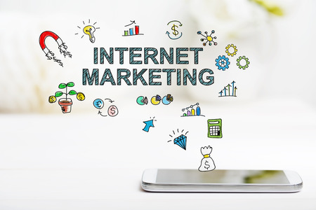 Internet Marketing concept with smartphone on white table Stockfoto