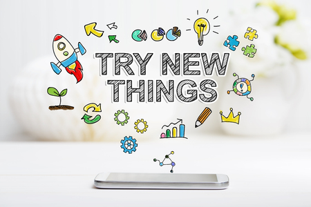 careers: Try New Things concept with smartphone on white table