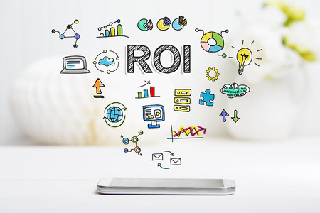 ROI concept with smartphone on white table