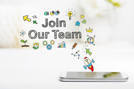 join: Join Our Team concept with smartphone on white table