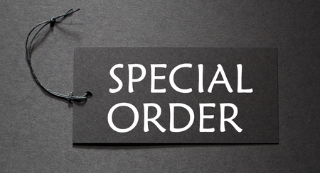 bespoke: Special Order text on a black tag on black paper background