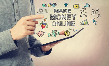 money online: Young man pointing at Make Money Online concept over a tablet computer
