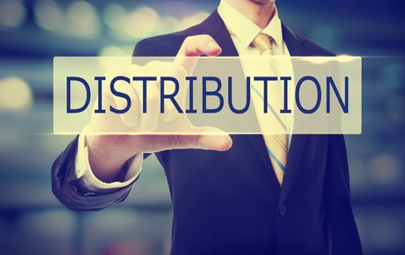 blue button: Business man holding Distribution on blurred abstract background