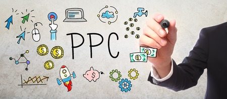 pen and marker: Businessman drawing PPC - Pay Per Click concept with a marker