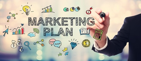 Businessman drawing Marketing Plan concept on blurred abstract background