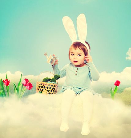 asian tulips: Toddler girl with rabbit ears in Easter theme