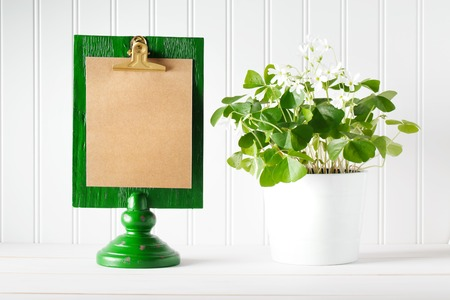 message board: Saint Patricks Day message board with shamrock in white pot