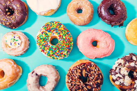 Assorted donuts on a pastel blue background