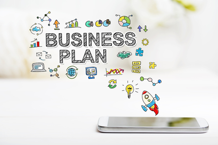 smartphone business: Business Plan concept with smartphone on white table Stock Photo