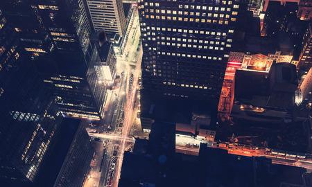 ny: Midtown Manhattan New York intersection illuminated by traffic at night