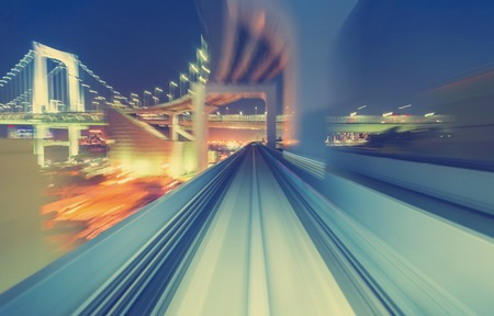 monorail: Abstract high speed technology POV motion blurred concept image from the Yuikamome monorail in Tokyo Japan Stock Photo