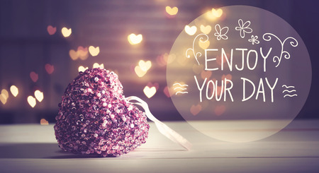 Enjoy Your Day message with pink heart with heart shaped lights Stock Photo